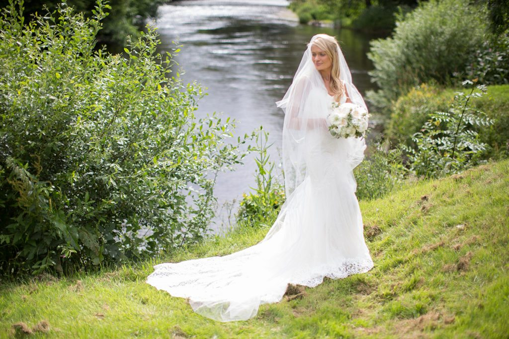 Nicola outdoors in her wedding dress