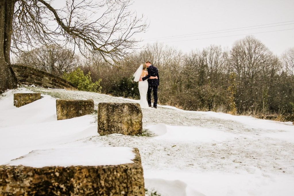 Bride and groom together in the snow