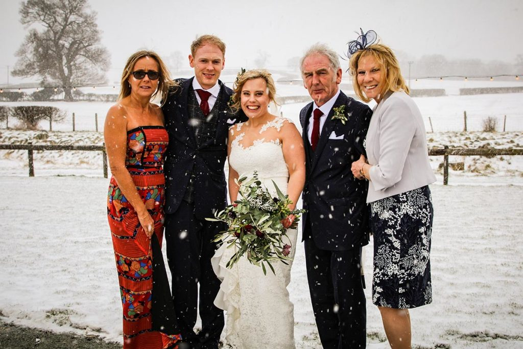 Family picture with bride and groom