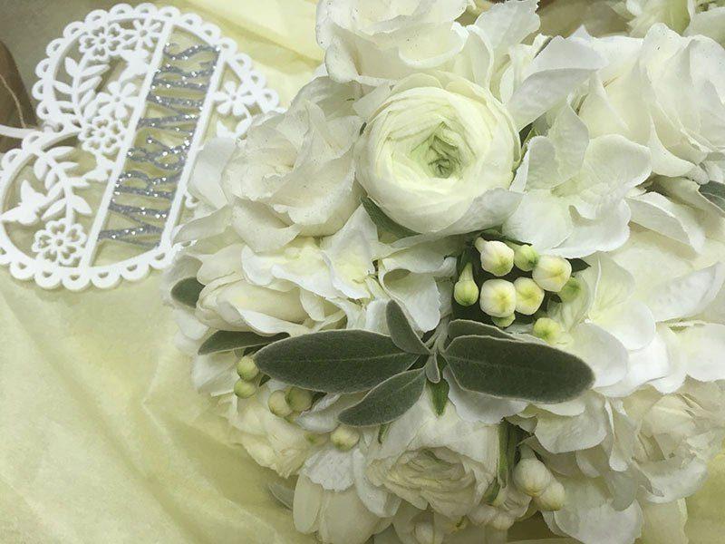 A white arrangement of flowers