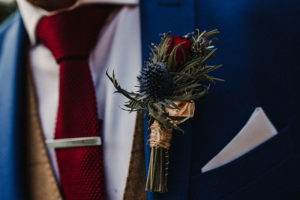 smart navy suit with thistle