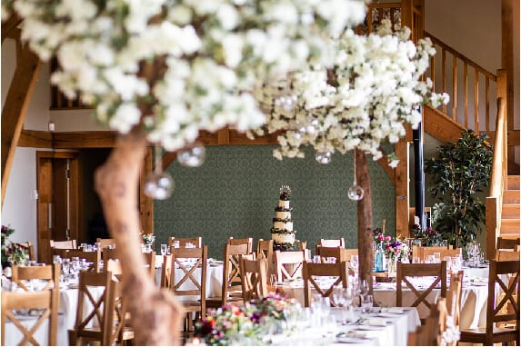 Set tables with lovely white flowers towering on top