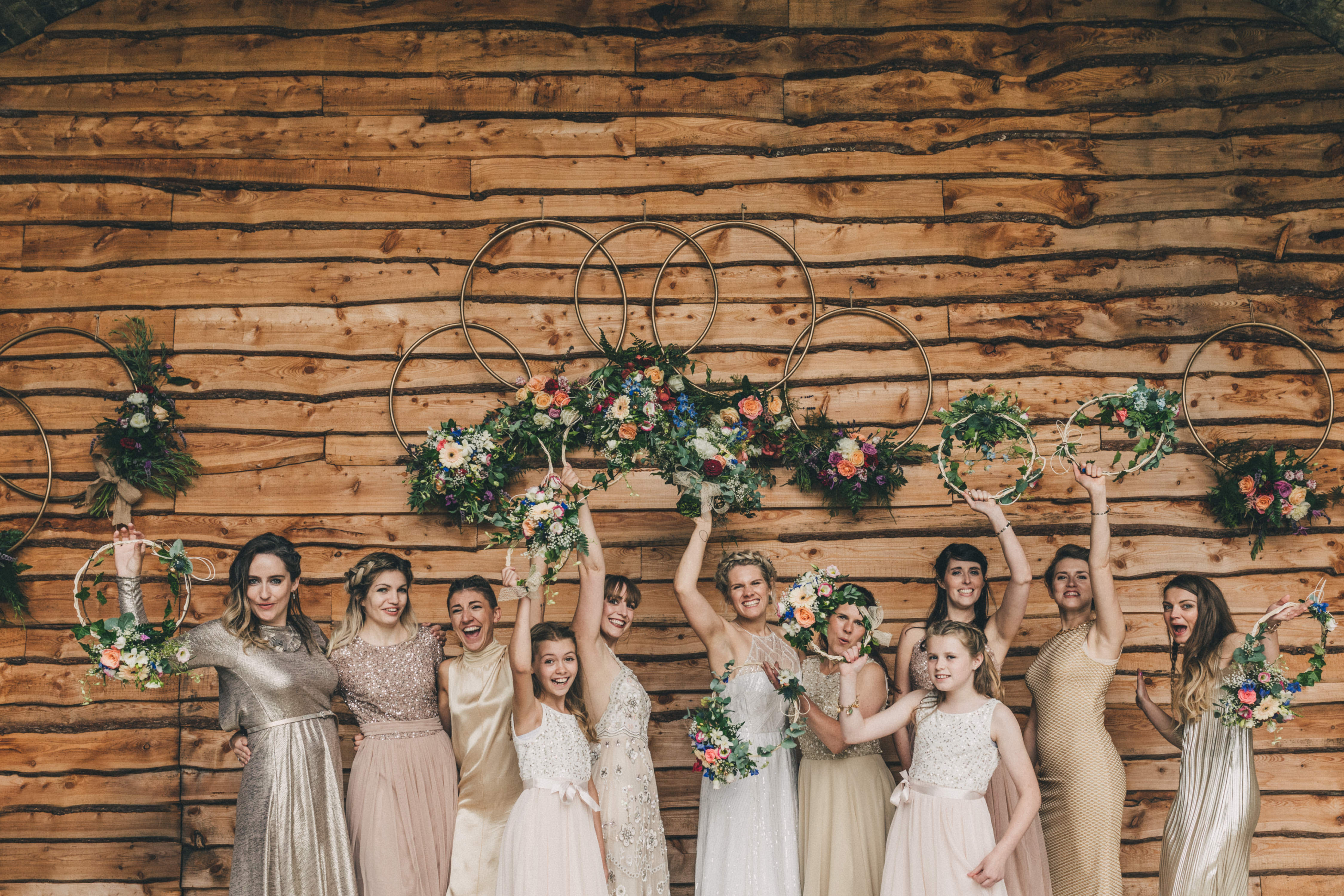 You can't have your wedding photos and not get this fun shot of the bridal party underneath the Old Railway Bridge here at Tower Hill Barns in North Wales, taken by Claire Penn Photography