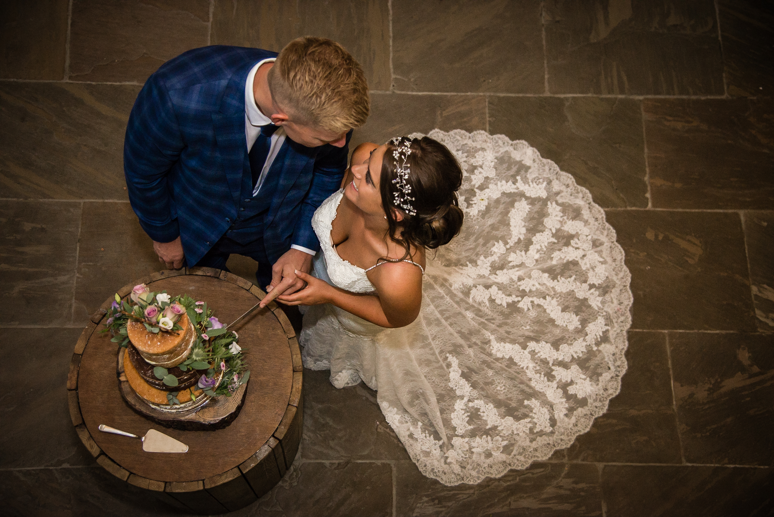 The romantic cutting of the cake shot, Stacey Oliver Photography