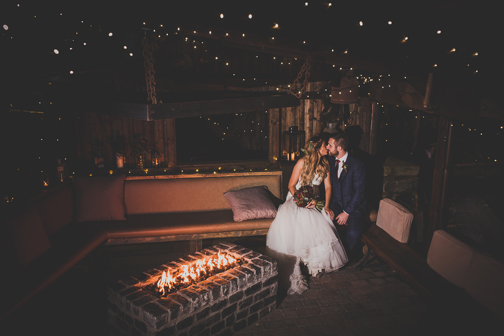Be sure to get this photo for your wedding photos, under the fairy lights in our outdoor bar at Tower Hill Barns