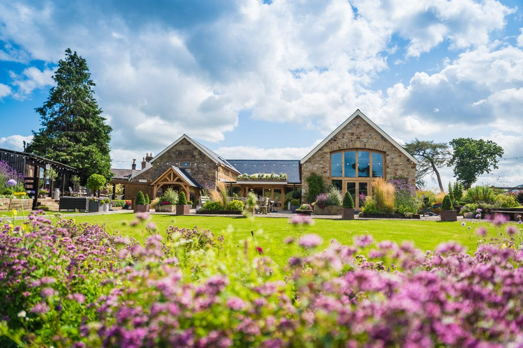 Tower Hill Barns luxury wedding venue during the summer in August 2019 with flower meadow in bloom